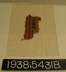 Fragment with yellow, red and brown bands