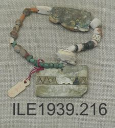 String of beads and rectangular pendants