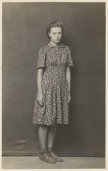 Standing woman in polka-dot dress