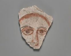 Wall painting fragment showing human face