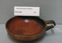 Black-glazed bowl with one handle