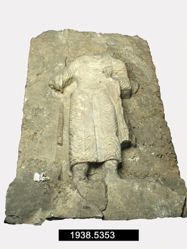 Relief of nimbate and radiate god with spear and sword