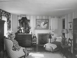 "Interior view of Katherine S. Dreier's West Redding home, ""The Haven"" -- KSD seated in bedroom, her face reflected in mirror"