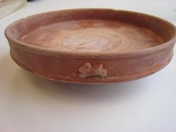 Footed plate with upright rim