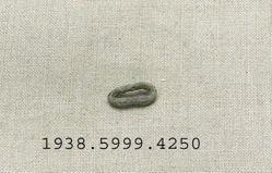 Bronze ring shaped fragment flattened