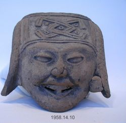 Smiling face with geometrically ornamented headdress