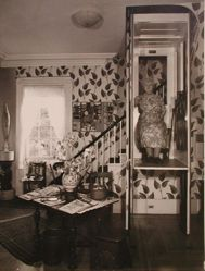 "Interior view of Katherine S. Dreier's Milford home, ""Laurel Manor"" -- KSD in elevator, sitting, frontal"