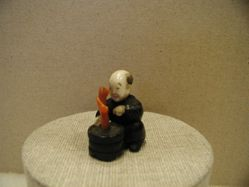 Seated Chinese Boy (karako) Holding a Tub with a Coral Plant