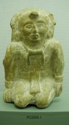 Whistle in shape of kneeling human figure