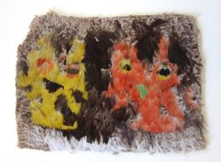 Fragment of cloth with feather decoration with stylized fish