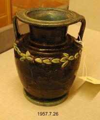Amphora with handles supporting large, fat lip.
