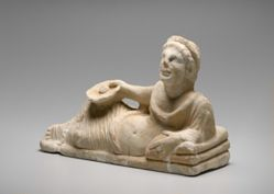 Reclining male figure, cover from a funerary urn