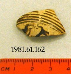 Pointed fragment of aryballos shoulder