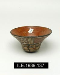 Small flaring bowl with vegetable and human head design
