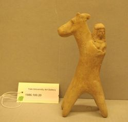 Horse and female rider figurine