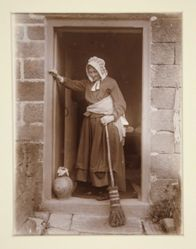 An Old Lady with a Yeast Bottle at a Cottage Door