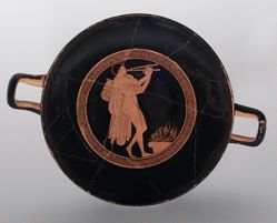 Kylix showing a Flute Player at an Altar