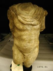 Statue of a nude male, wearing chlamys