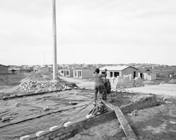 Man building his house, Marselle Township, Kenton-on-sea