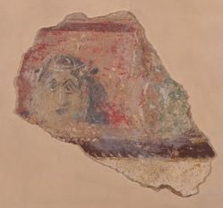 Fragment of wall painting showing a theatrical mask
