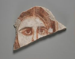 Wall painting fragment showing female face