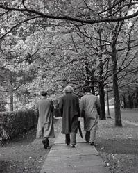 Physicists Peter Bergmann, Albert Einstein, and Valentine Bargmann walk through the Princeton Campus