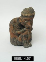 Figure of seated woman