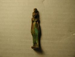 A glazed pendant of a feline goddess