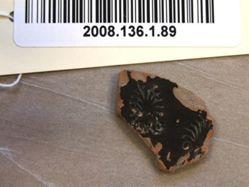 Black glazed fragment with impressed palmettes