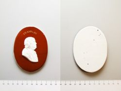 Glazed porcelain plaque of Benjamin Franklin