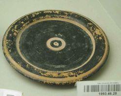 Black glaze plate with rilled rim