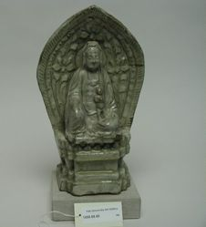 Figure of seated Guanyin with halo