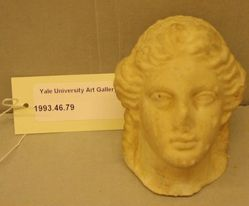 Small head of Dionysos (or Apollo?) from a figurine